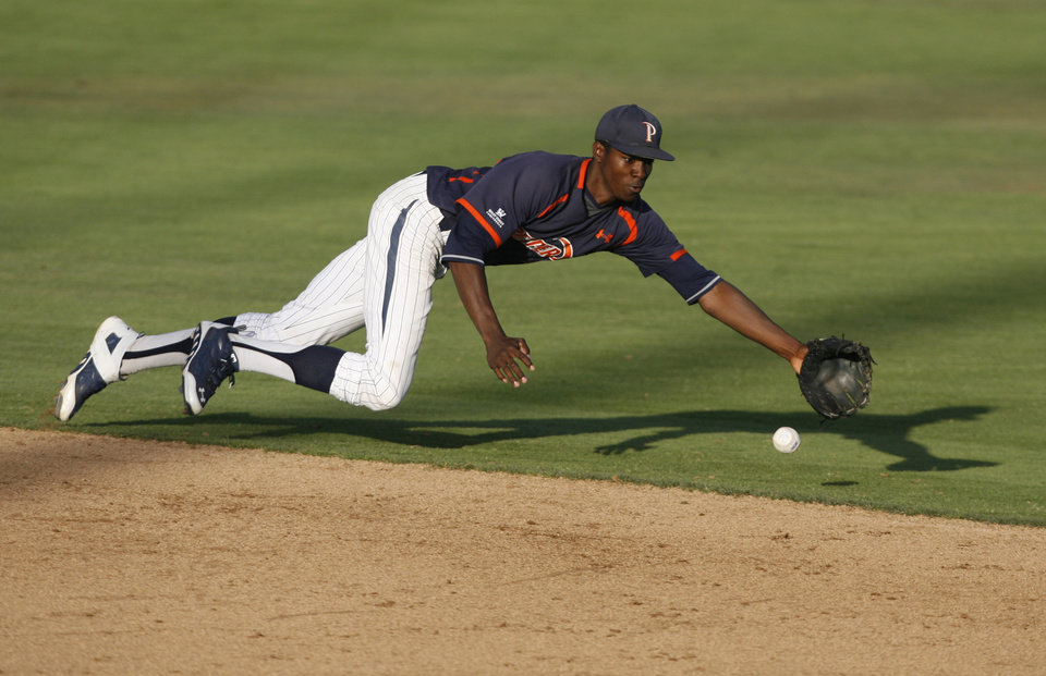 Photo - Pepperdine's Manny Jefferson comes up short as he dives for a grounder during the second inning of an NCAA college baseball tournament regional game against Cal Poly on Sunday, June 1, 2014, at Baggett Stadium at Cal Poly in San Luis Obispo, Calif. (AP Photo/Aaron Lambert)