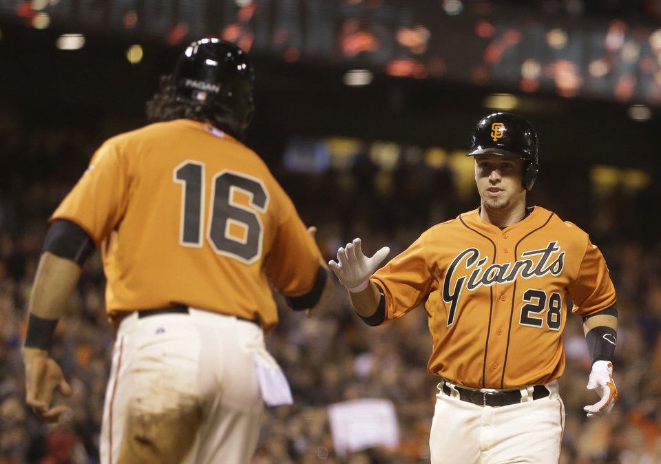 Photo - San Francisco Giants' Buster Posey, right, is congratulated by Angel Pagan (16) after Posey hit a two run home run off New York Mets' Carlos Torres in the eighth inning of a baseball game Friday, June 6, 2014, in San Francisco. (AP Photo/Ben Margot)