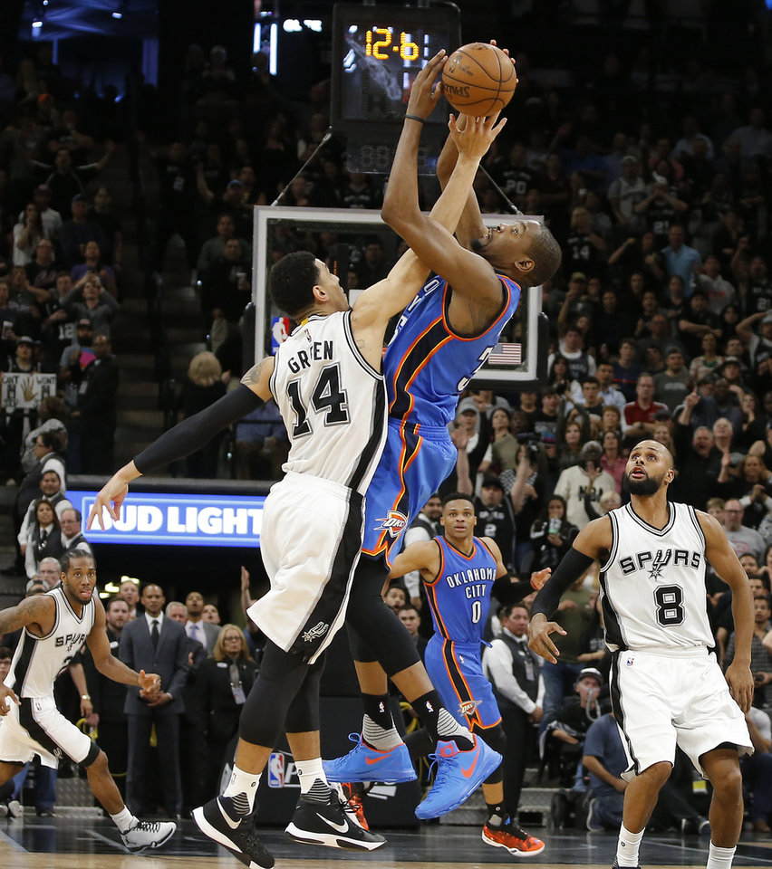Photo - Oklahoma City's Kevin Durant (35) and San Antonio's Danny Green (14) leap for the ball during the final seconds in Game 2 of the second-round series between the Oklahoma City Thunder and the San Antonio Spurs in the NBA playoffs at the AT&T Center in San Antonio, Monday, May 2, 2016. Oklahoma City won 98-97. Photo by Bryan Terry, The Oklahoman