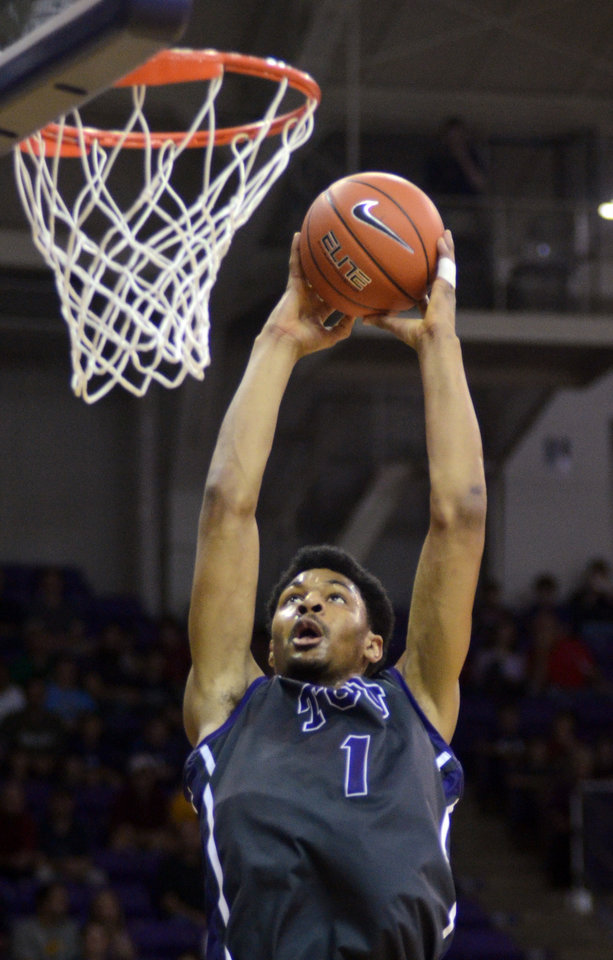Photo - TCU's Karviar Shepherd dunks the ball against Iowa State during the first half of an NCAA college basketball game, Saturday, Feb. 22, 2014 in Fort Worth, Texas. (AP Photo/The Fort Worth Star-Telegram, Bob Haynes)  MAGS OUT; (FORT WORTH WEEKLY, 360 WEST); INTERNET OUT