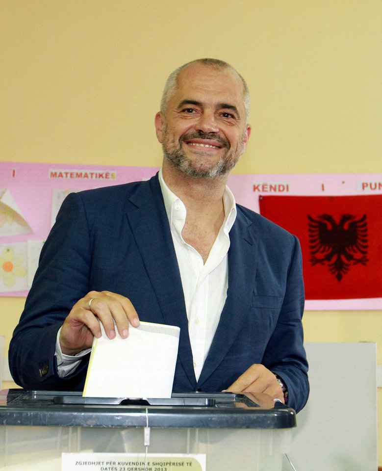 Photo - Main opposition Socialist Party leader Edi Rama poses for photographers before he casts his ballot during elections in Tirana, Albania, Sunday, June 23, 2013. Socialist leader Edi Rama and his close rival Prime Minister Sali Berisha of the Democratic Party have hopes for eventual entry to the European Union, but the bloc has expressed concern over whether the country can manage to run fair and free elections. (AP Photo/Hektor Pustina)