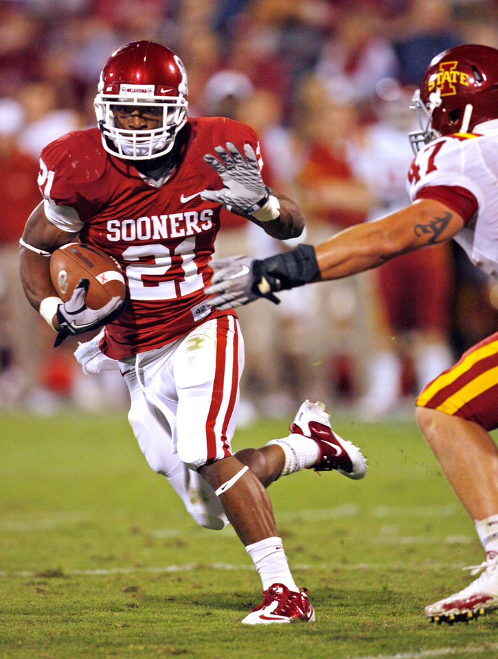 Photo - Brennan Clay (21) carries during the second half of the college football game between the University of Oklahoma Sooners (OU) and the Iowa State Cyclones (ISU) at the Gaylord Family-Oklahoma Memorial Stadium on Saturday, Oct. 16, 2010, in Norman, Okla.  Photo by Steve Sisney, The Oklahoman