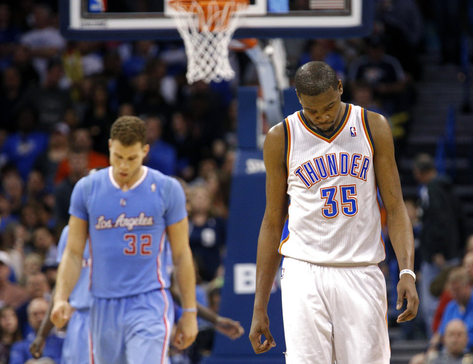 Photo - Oklahoma City's Kevin Durant reacts as he walks up the court in front of Los Angeles' Blake Griffin (32) during the NBA game between the Oklahoma City Thunder and the Los  Angeles Clippers at the Chesapeake Energy Arena, Sunday, Feb. 23, 2014. Photo by Sarah Phipps, The Oklahoman