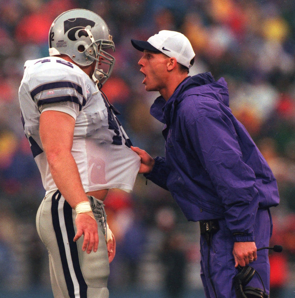 FILE-- Brent Venables, right, football linebacker coach for Kansas State  talking to linebacker Mark Simoneau in this Oct.31, 1998 file photo, has taken a job at Oklahoma Tuesday Dec. 8, 1998, as a defensive coordinator. He will share defensive coaching duties with Mike Stoops. (AP Photo/The Topeka Capital-Journal, Chris Lee, file)