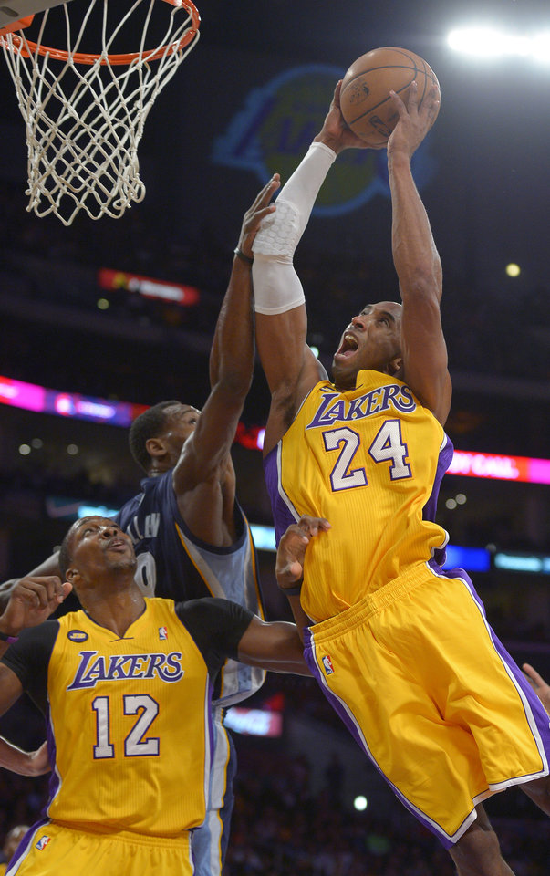 Los Angeles Lakers guard Kobe Bryant, right, puts up a shot as Memphis Grizzlies guard Tony Allen, center defends and center Dwight Howard looks on during the first half of their NBA basketball game, Friday, April 5, 2013, in Los Angeles. The Lakers won 86-84. (AP Photo/Mark J. Terrill)