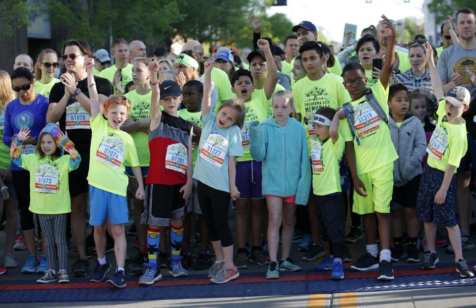 Photo - Children wait for the start of the  kids marathon during the Oklahoma City Marathon in Oklahoma City,  Sunday, April 29, 2018. Photo by Sarah Phipps, The Oklahoman