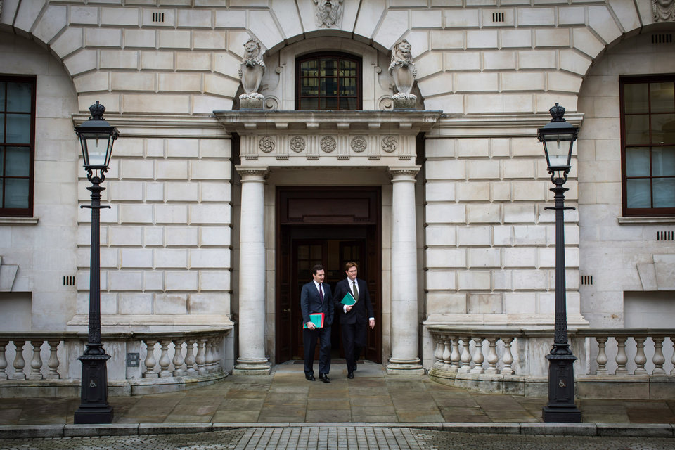 Britain's Chancellor of the Exchequer, George Osborne, left, walks with Chief Secretary to the Treasury, Danny Alexander, to deliver the half-yearly budget statement to parliament in London, Wednesday Dec. 5, 2012. Britain's Treasury chief, George Osborne, unveiled plans to kick-start the U.K.'s moribund economy when he presented his updated budget policies to lawmakers. (AP Photo/Paul Rogers, Pool)