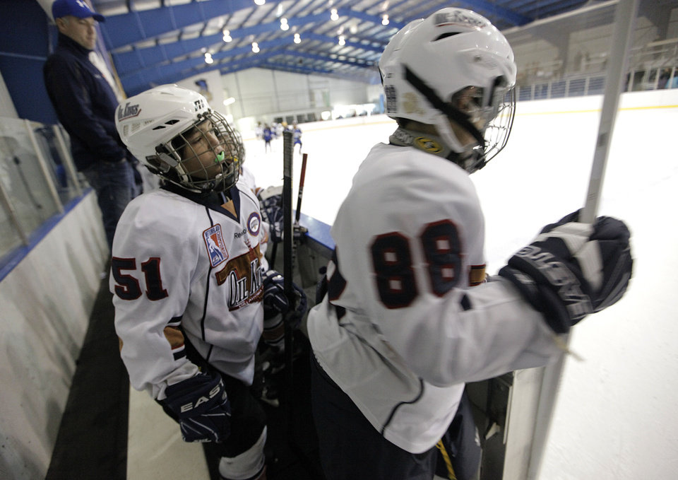 Taze Thompson, left, and Gehrig Miller take the ice Sunday in a game between the Oklahoma City Oil Kings and the New Mexico Warriors during the Oktoberfest 2012 youth hockey tournament at Arctic Edge Arena in Oklahoma City.  Photo by Garett Fisbeck, The Oklahoman <strong>Garett Fisbeck</strong>
