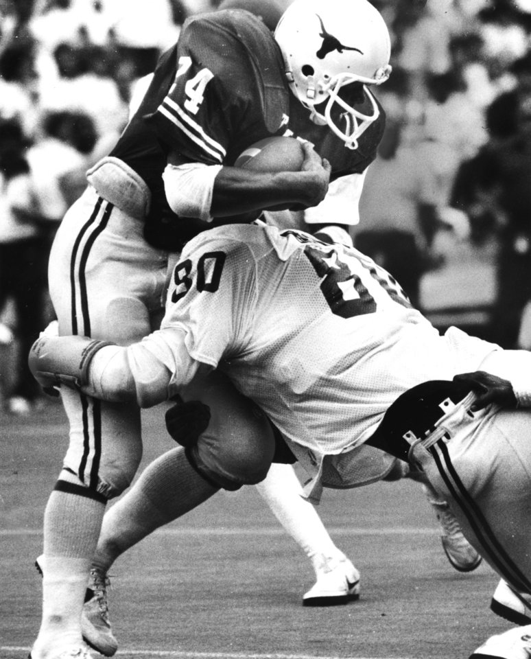 Oklahoma defensive tackle Rick Bryan crunches Texas' A.J. 'Jam' Jones during the Sooners-Longhorns shoot-out in the Cotton Bowl. The Longhorns beat the Sooners 34-14. Staff photo by Doug Hoke taken 10/10/81