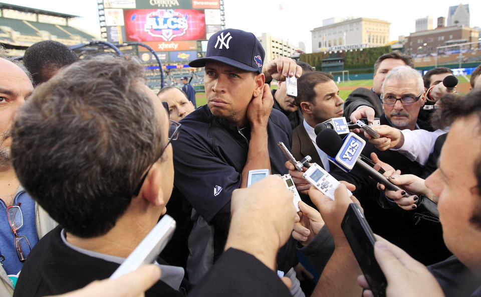 Photo -   New York Yankees' Alex Rodriguez listens to a question from the media before Game 4 of the American League championship series against the Detroit Tigers Wednesday, Oct. 17, 2012, in Detroit. (AP Photo/Carlos Osorio)