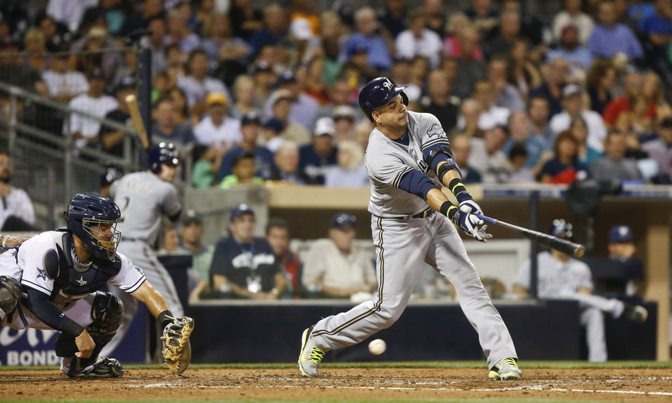 Photo - Milwaukee Brewers' Aramis Ramirez chases a low slider in the fourth inning of a baseball game against the San Diego Padres on Tuesday, Aug. 26, 2014, in San Diego. The Padres catcher is Rene Rivera. Ramirez struck out with a runner on third. (AP Photo/Lenny Ignelzi)