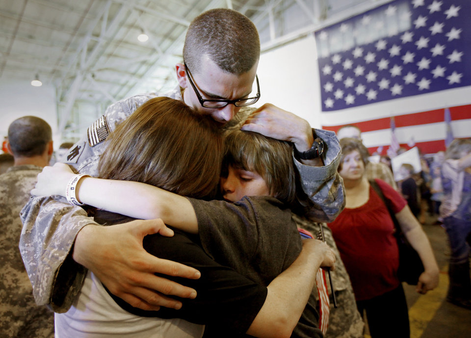 Spc. Tadd Hendrickson is greeted by his mother Kendra Beller, left, and his brother Trevor Rutledge, 12, after returning from Kuwait with the Oklahoma National Guard's 180th Cavalry Squadron at the Will Rogers Air National Guard Base in Oklahoma City, Saturday, March 31, 2012. A homecoming ceremony welcomed about 180 soldiers from the Oklahoma National Guard's 180th Cavalry Squadron returning from Kuwait along with members of the Oklahoma National Guard's 45th Infantry Brigade Combat Team returning from Afghanistan. Photo by Bryan Terry, The Oklahoman