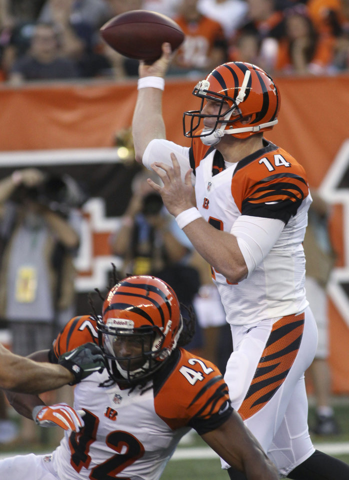 Photo -   Cincinnati Bengals quarterback Andy Dalton (14) passes against the New York Jets in the first half of an NFL preseason football game, Friday, Aug. 10, 2012, in Cincinnati. (AP Photo/Tom Uhlman)