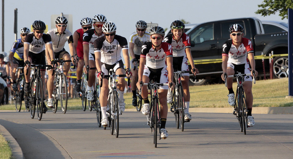 Photo - Riders begin the 17th annual Norman Conquest bicycle ride on Saturday in Norman. More than 650 people took in the ride that is sponsored by the Bicycle League of Norman and benefits the J.D. McCarty Center's summer camp scholarship fund that sends disadvantaged kids to camp. Cyclists had a choice of four routes ranging from 10 to 64 miles.  Photos by Steve Sisney, The Oklahoman