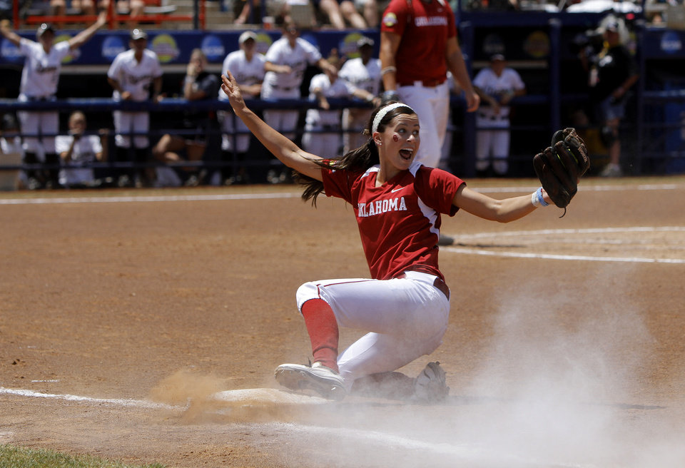 Photo - Oklahoma's Brianna Turang (2) reacts after a Missouri player was called safe at first in the third inning of a Women's College World Series softball game between the University Oklahoma and Missouri at ASA Hall of Fame Stadium in Oklahoma City, Saturday, June 4, 2011.  Missouri won, 4-1. Photo by Bryan Terry, The Oklahoman