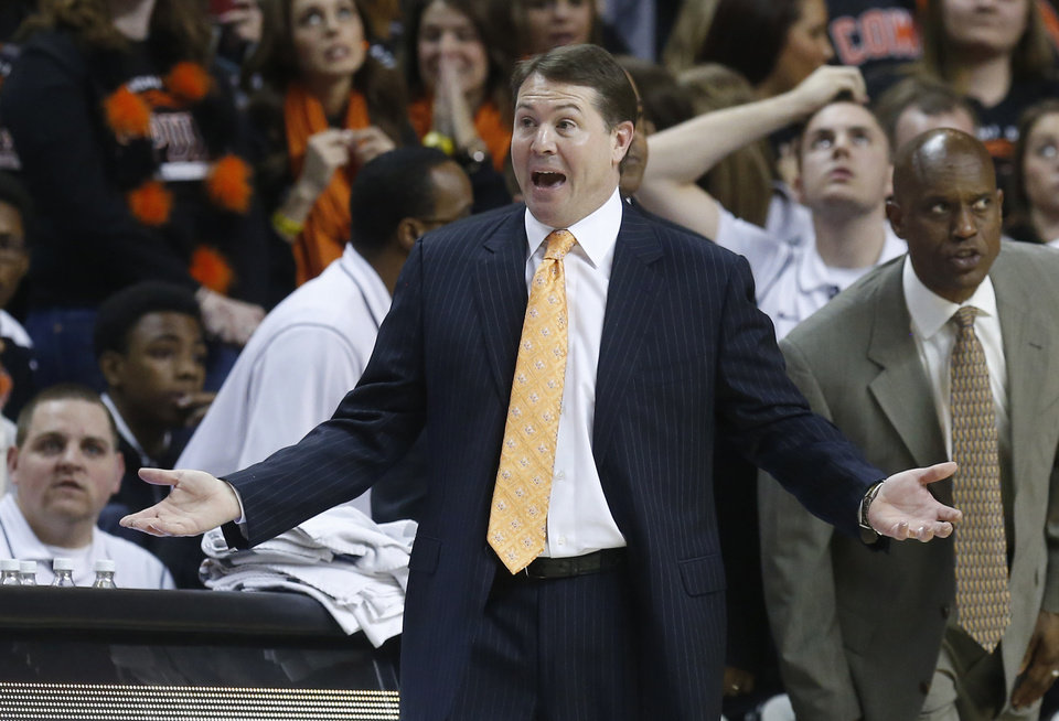 Oklahoma State head coach Travis Ford gestures in the first half of an NCAA college basketball game against Kansas in Stillwater, Okla., Wednesday, Feb. 20, 2013. Kansas won 68-67 in double overtime. (AP Photo/Sue Ogrocki) ORG XMIT: OKSO140