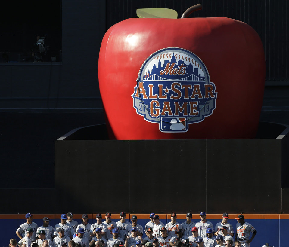 Photo - Players on the American League team pose for a group photo beneath the home run apple at Citi Field before the MLB All-Star baseball game, on Tuesday, July 16, 2013, in New York. (AP Photo/Matt Slocum)