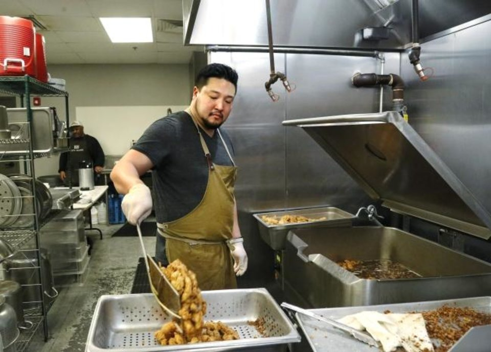 Photo - Chef Kevin Lee and his crew cooked and served a hot lunch for 300 clients at The Homeless Alliance on Wednesday, Feb. 20, 2019.  Photo by Jim Beckel, The Oklahoman.