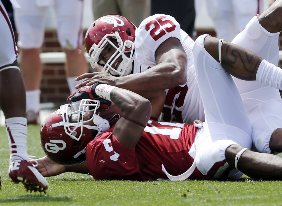 Aaron Franklin (25) brings down Derrick Woods (12) after a catch during the annual Spring Football Game at Gaylord Family-Oklahoma Memorial Stadium in Norman, Okla., on Saturday, April 13, 2013. Photo by Steve Sisney, The Oklahoman