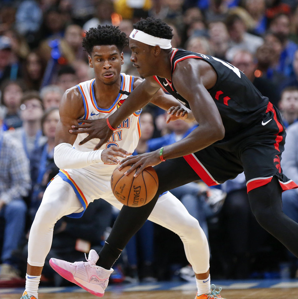 Photo - Oklahoma City's Shai Gilgeous-Alexander (2) defends Toronto's Pascal Siakam (43) in the second quarter during an NBA basketball between the Oklahoma City Thunder and the Toronto Raptors at Chesapeake Energy Arena in Oklahoma City, Wednesday, Jan. 15, 2020. [Nate Billings/The Oklahoman]