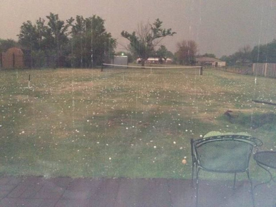 Tennis anyone? asks Leslie Berger in submitting this user photo of hail on a lawn tennis court Tuesday night.