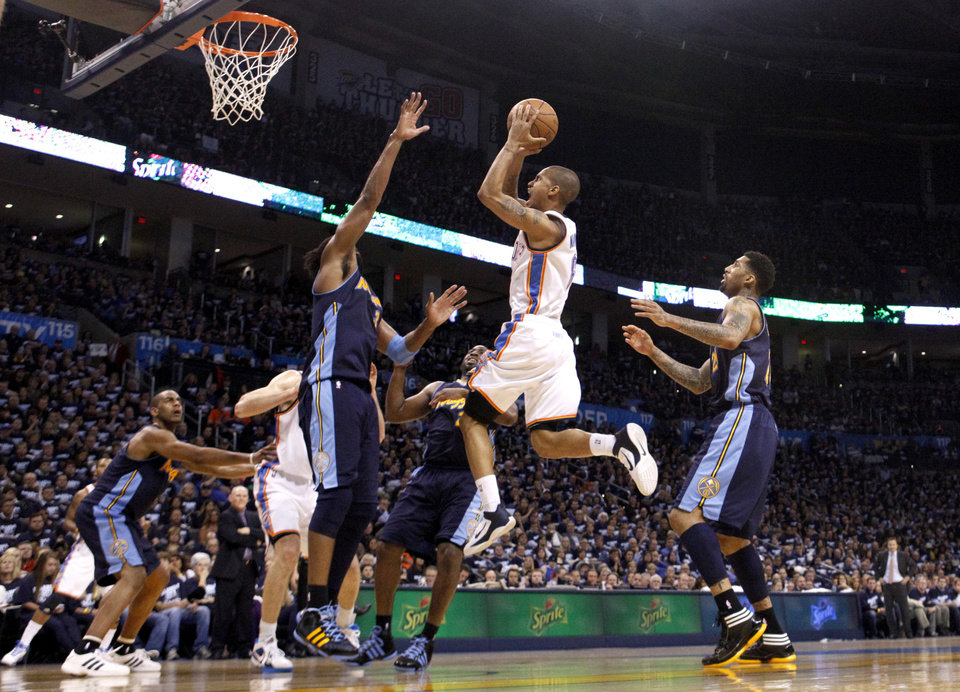 Oklahoma City's Eric Maynor (6) shoots a layup during the NBA basketball game between the Denver Nuggets and the Oklahoma City Thunder in the first round of the NBA playoffs at the Oklahoma City Arena, Wednesday, April 27, 2011. Photo by Sarah Phipps, The Oklahoman