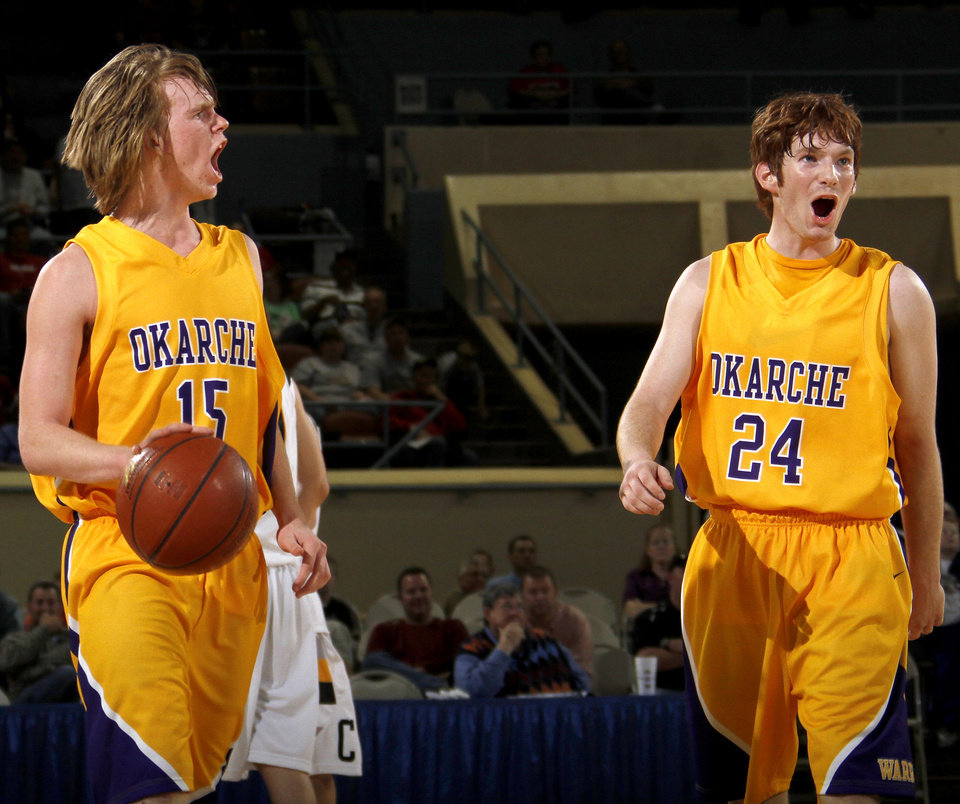 Photo - Okarche's Jabe Karr, left, and Jacob Moffat celebrate after winning their game against Caddo in the Class A boys basketball state tournament at the State Fair Arena in Oklahoma City, Friday, March 5, 2010.  Photo by Bryan Terry, The Oklahoman