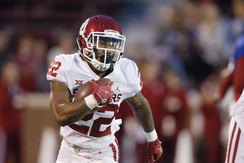 Photo - Oklahoma's T.J. Pledger (22) carries the ball during the University of Oklahoma's (OU) spring football game at Gaylord Family-Oklahoma Memorial Stadium in Norman, Okla., Friday, April 12, 2019. Photo by Bryan Terry, The Oklahoman