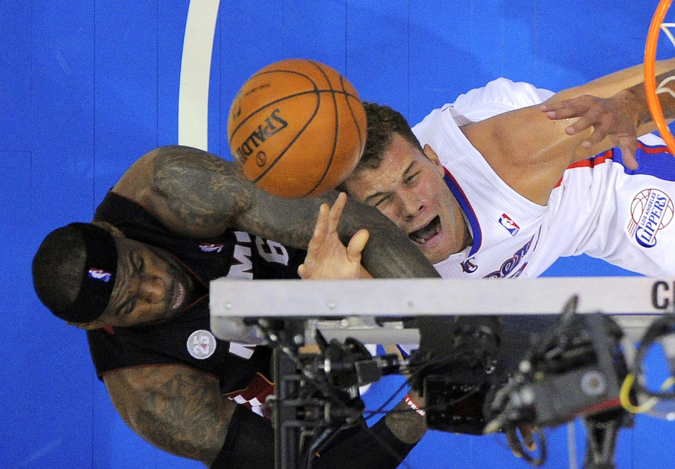 Los Angeles Clippers forward Blake Griffin, right, shoots as Miami Heat forward LeBron James defends during the first half of their NBA basketball game, Wednesday, Nov. 14, 2012, in Los Angeles. (AP Photo/Mark J. Terrill)