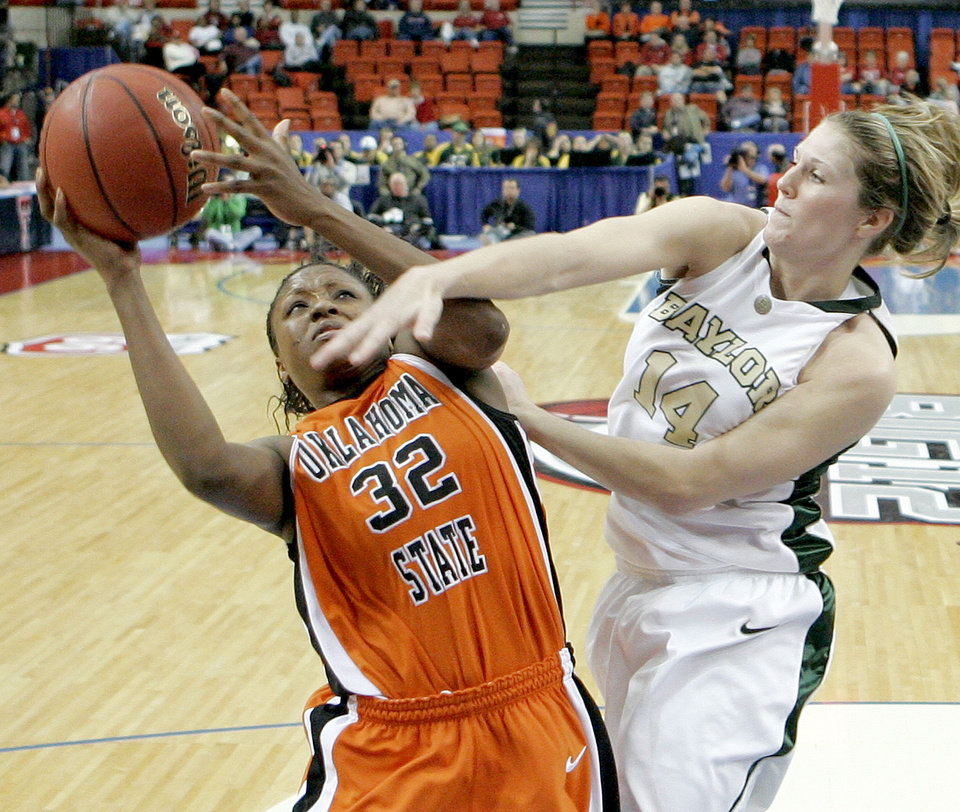 Photo - OSU's Shaunte' Smith goes to the bucket beside Baylor's Rachel Allison during the Big 12 Women's Championship game between Oklahoma State and Baylor at the Cox Center in Oklahoma City, Friday, March 13, 2009. OSU lost to Baylor 67-62.  PHOTO BY BRYAN TERRY, THE OKLAHOMAN