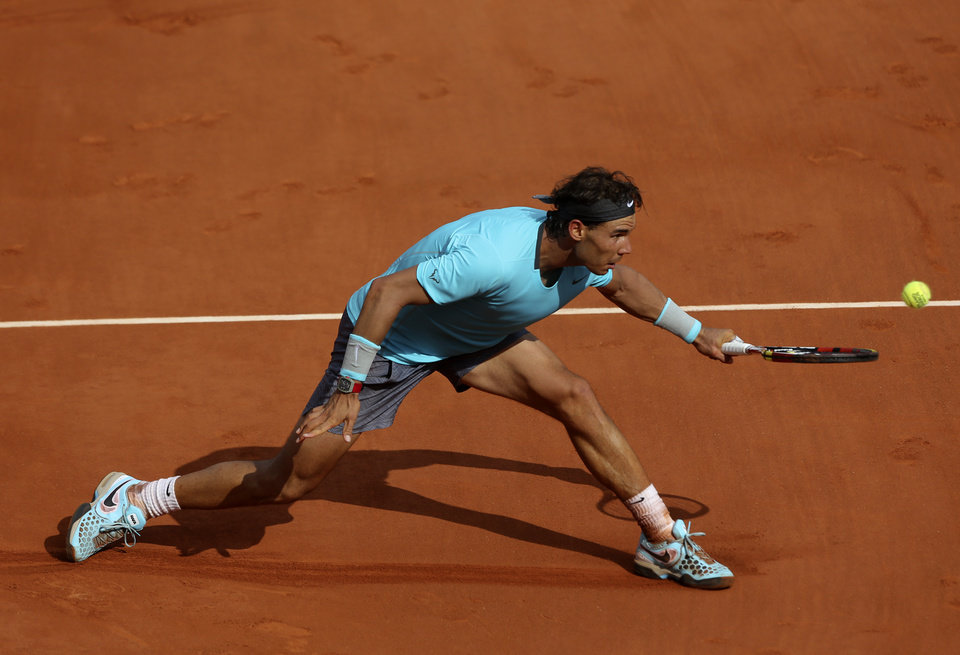 Photo - Spain's Rafael Nadal returns the ball to Serbia's Novak Djokovic during their final match of  the French Open tennis tournament at the Roland Garros stadium, in Paris, France, Sunday, June 8, 2014. (AP Photo/Thibault Camus)