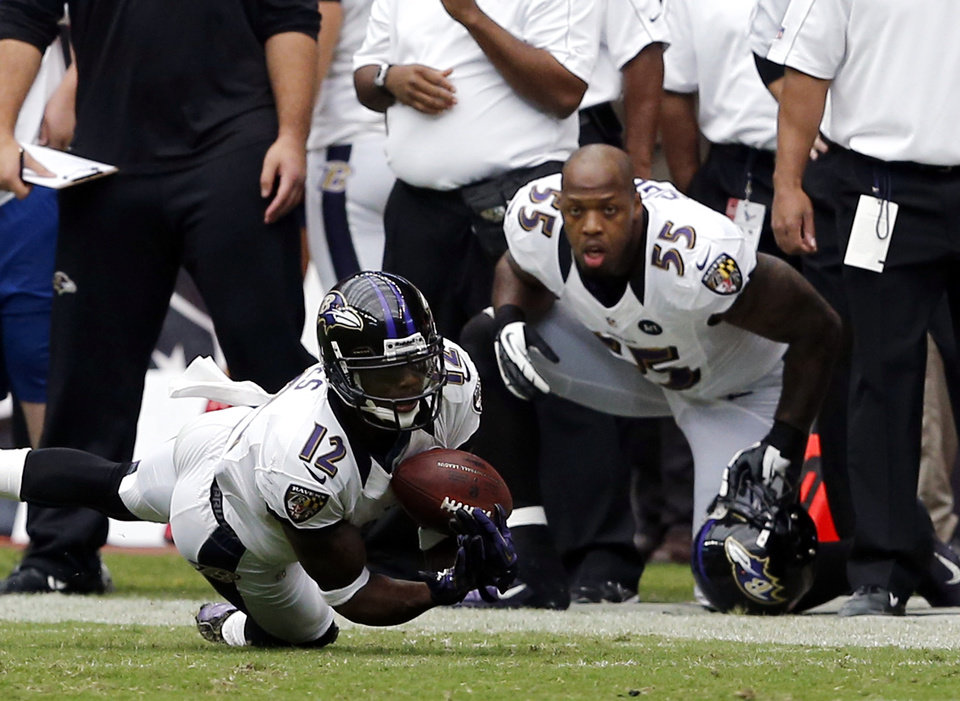 Photo -   Baltimore Ravens wide receiver Jacoby Jones (12) makes a catch during the second half of an NFL football game against the Houston Texans on Sunday, Oct. 21, 2012, in Houston. (AP Photo/Waco Tribune Herald, Jose Yau)