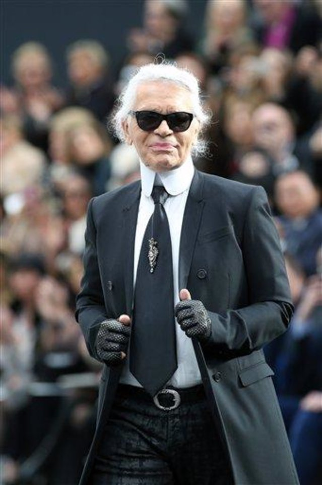 German fashion designer Karl Lagerfeld acknowledges applause at the end of Chanel\'s Fall/Winter 2013-2014 ready to wear collection, in Paris, Tuesday, March, 5, 2013. (AP Photo/Thibault Camus)