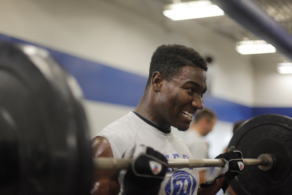 COLLEGE FOOTBALL: Donavon McLeod, a sophomore, lifts weights at Northeastern Oklahoma A&M College in Miami, Okla., Wednesday, July 18, 2012. Photo by Garett Fisbeck, The Oklahoman