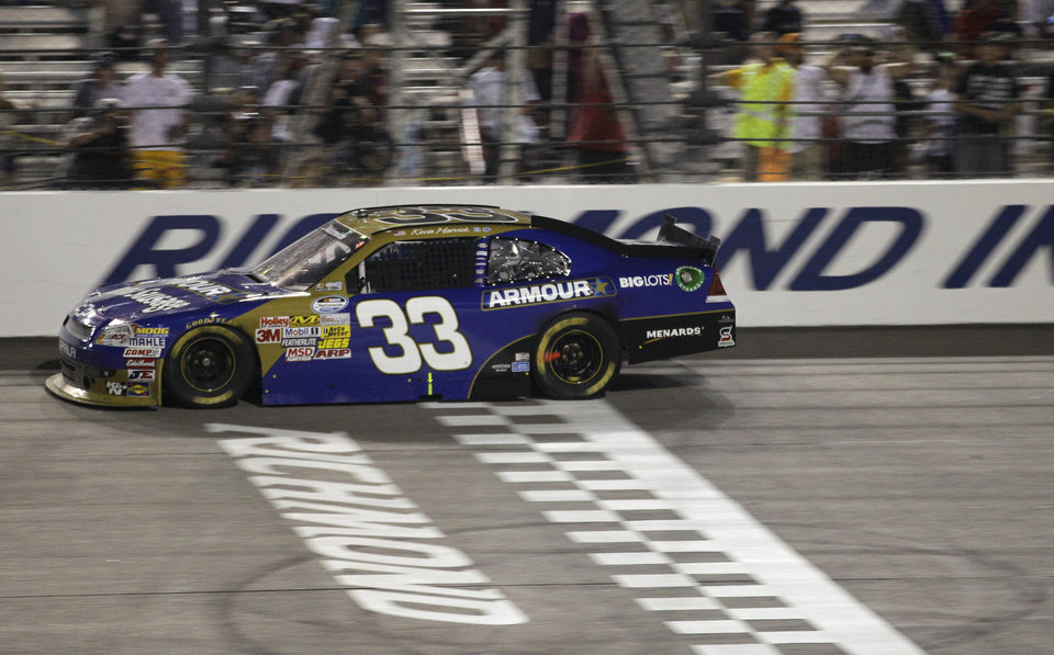 Photo -   Kevin Harvick crosses the finish line to win the NASCAR Nationwide Series auto race at Richmond International Raceway in Richmond, Va., Friday, Sept. 7, 2012. (AP Photo/Steve Helber)