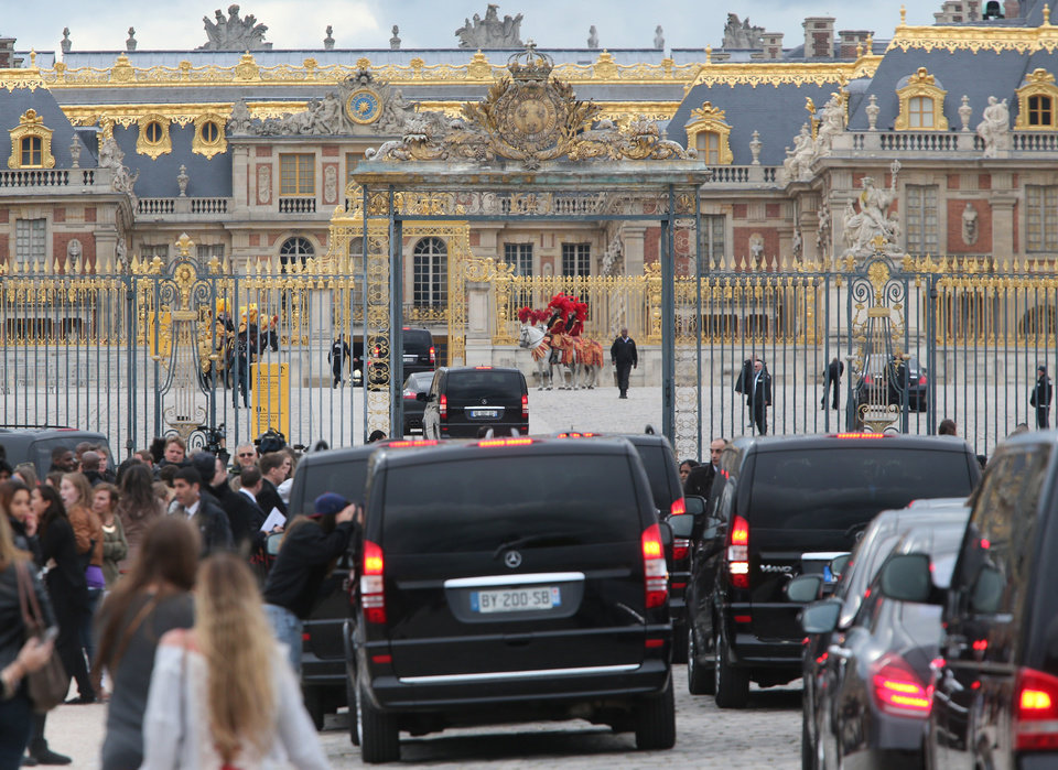 Photo - FILE - In this May 23, 2014 file photo, fans gather to watch guests arriving, as they look inside one of the cars for Kim Kardashian, Kanye West and their guests, at the entrance  of the Chateau de Versailles  in Versailles, France, west of Paris.  The gates of the Chateau de Versailles, once the digs of Louis XIV, were opened to Kardashian, West and their guests for a private evening on the eve of their marriage. 150 guests attended a welcome dinner at Versailles, the reality TV star told The Associated Press in a recent interview.