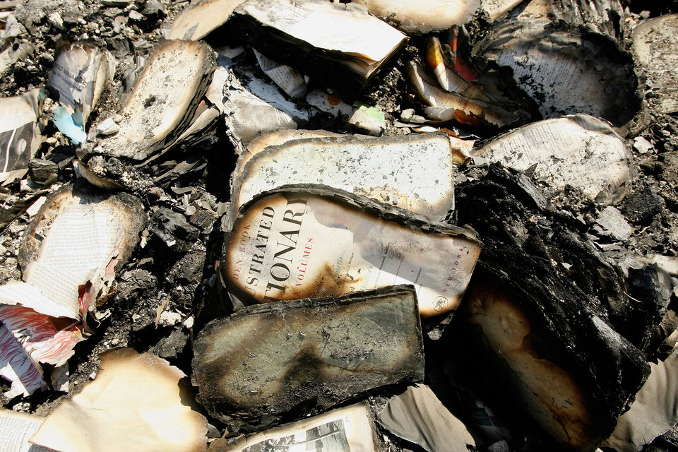 Burnt books are all that remain of the library for the Sallateeska Baptist Church north of Shawnee Wednesday, Feb. 27, 2008. A grass fire burned the church to the ground Monday. BY PAUL B. SOUTHERLAND, THE OKLAHOMAN