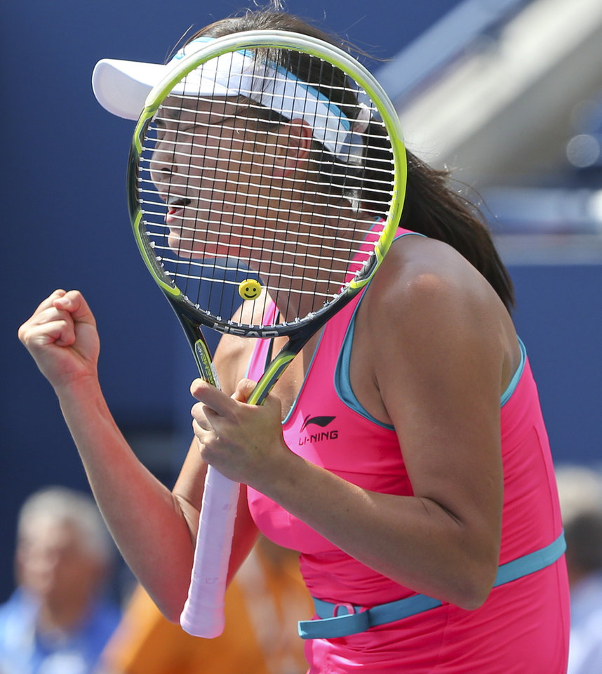 Photo - Peng Shuai, of China, reacts after defeating Belinda Bencic, of Switzerland, during the quarterfinals of the 2014 U.S. Open tennis tournament, Tuesday, Sept. 2, 2014, in New York. (AP Photo/Mike Groll)