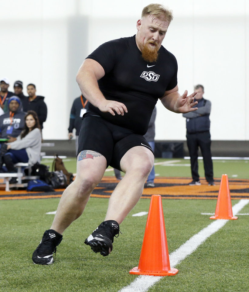 Photo - Oklahoma State offensive lineman Johnny Wilson runs a drill during OSU Pro Day inside the Sherman E. Smith Training Center in Stillwater, Okla., Tuesday, March 10, 2020. [Nate Billings/The Oklahoman]