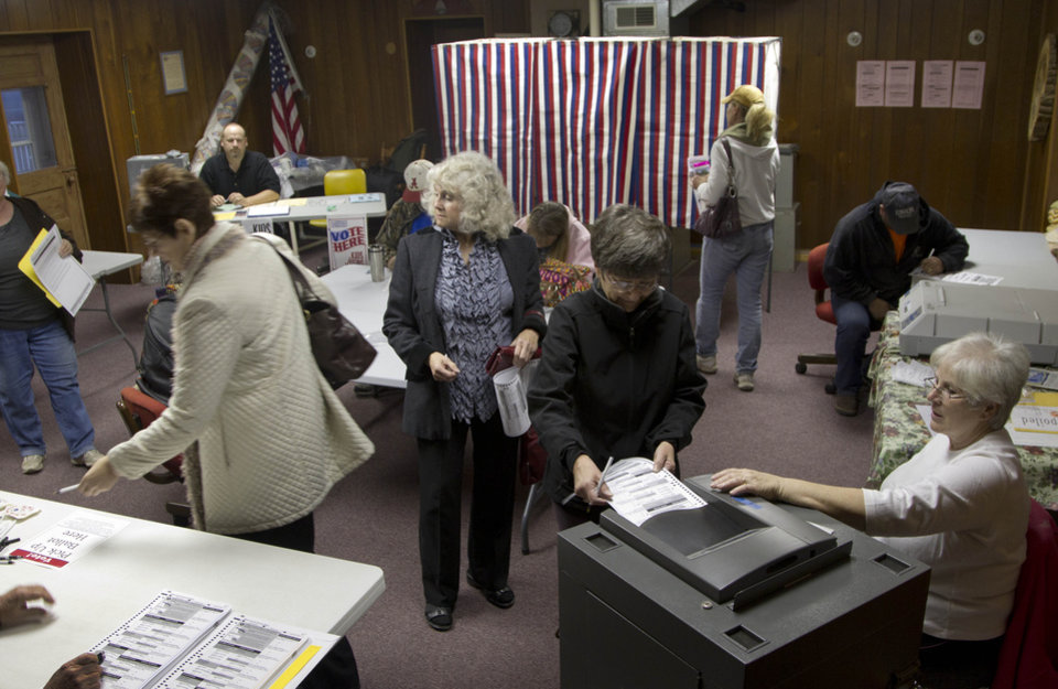 Voters cast their ballots at the old Clinton Town Hall in Clinton, Kan., Tuesday, Nov. 6, 2012. (AP Photo/Orlin Wagner)