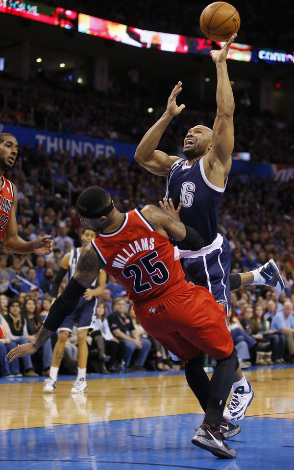 Photo - Oklahoma City's Derek Fisher is fouled by Portland's Mo Williams during an NBA basketball game between the Oklahoma City Thunder and the Portland Trail Blazers at Chesapeake Energey Arena in Oklahoma City, Tuesday, December 31, 2013. Photo by Bryan Terry, The Oklahoman