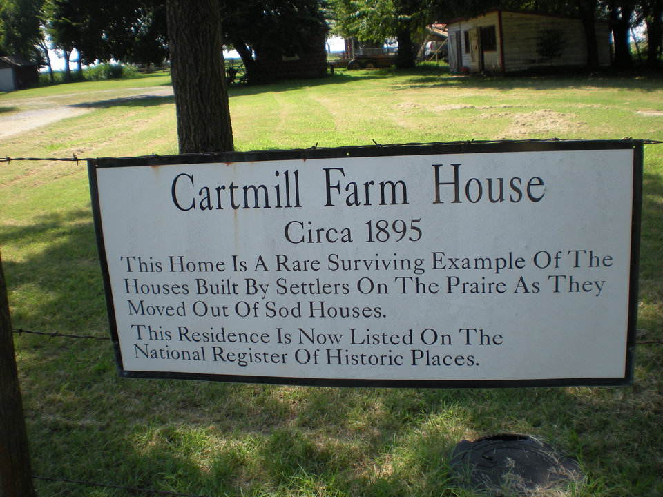 Photo - Right:  This sign describes the Cartmill Farm House at 21751 N MacArthur Blvd.  Photos by Mary Phillips, For The Oklahoman
