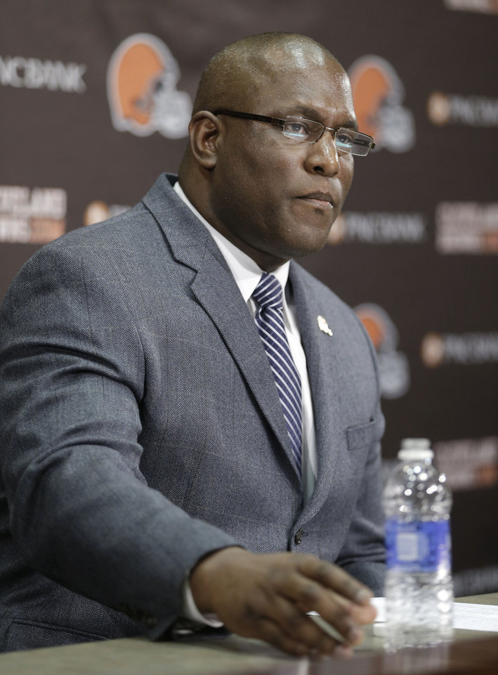 Photo - Cleveland Browns general manager Ray Farmer answers questions during a news-conference Tuesday, Feb. 11, 2014, in Berea, Ohio. Farmer, who was pursued by Miami to be the Dolphins' GM this winter, has been promoted and will immediately take the over the team's football operations and lead the Browns during free agency and draft. Cleveland has two first-round picks in May's draft and is well under the salary cap to spend on free agents. (AP Photo/Tony Dejak)