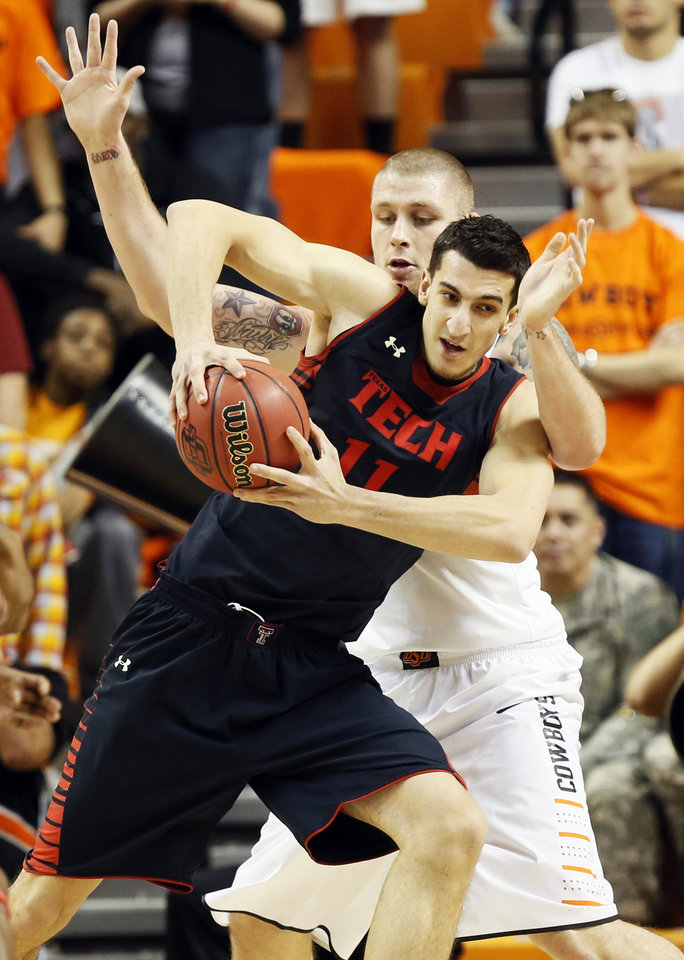 Texas Tech\'s Dejan Kravic (11) works against Oklahoma State\'s Philip Jurick (44) during a men\'s college basketball game between Oklahoma State University (OSU) and Texas Tech at Gallagher-Iba Arena in Stillwater, Okla., Saturday, Jan. 19, 2013. Photo by Nate Billings, The Oklahoman