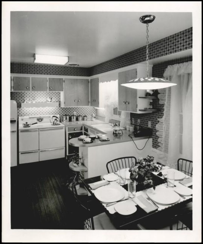 Photo -  1956: A cozy kitchen with eating area. [THE OKLAHOMAN ARCHIVES]
