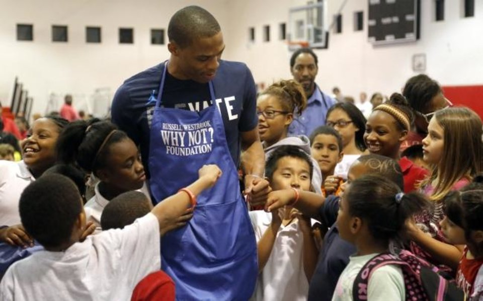 Photo -  Russell Westbrook, shown here during a Thanksgiving visit to the Boys & Girls Club of Oklahoma County in 2012, will be back in Oklahoma City Thursday night. [Sarah Phipps/The Oklahoman]
