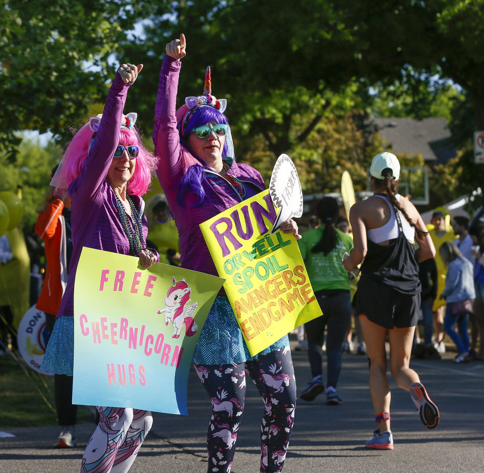 Photo - Karen Kurtz, left, and Jennifer McClintock cheer on runners along Gorilla Hill near NW 40 and Shartel during the Oklahoma City Memorial Marathon in Oklahoma City, Sunday, April 28, 2019. [Nate Billings/The Oklahoman]
