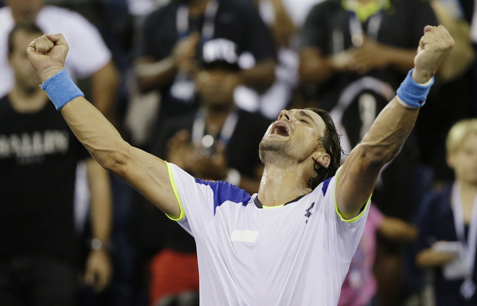 David Ferrer, of Spain, reacts after beating Janko Tipsarevic, of Serbia, during the fourth round of the 2013 U.S. Open tennis tournament, Monday, Sept. 2, 2013, in New York. (AP Photo/David Goldman)