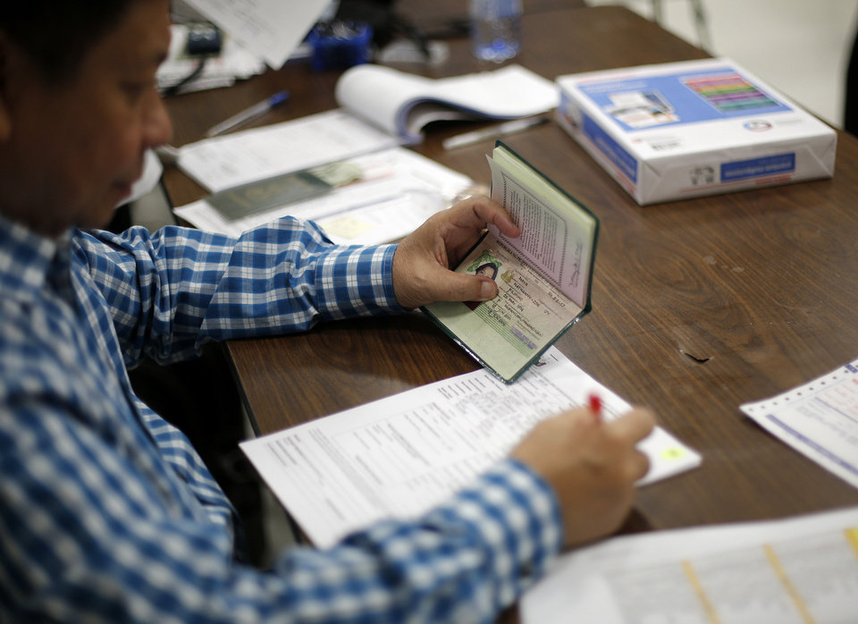 Filipino diplomats renew passports at St. Eugene Catholic Church in Oklahoma City.  Photo by Garett Fisbeck, The Oklahoman <strong>Garett Fisbeck - Garett Fisbeck</strong>