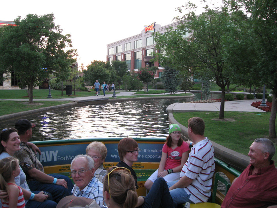 Photo - The same view of the Bricktown Canal today shows the once undeveloped Lower Bricktown built into a mix of restaurants, shops, a hotel and entertainment venues.PHOTO PROVIDED BY WATER TAXI ORG XMIT: 0906270157271163